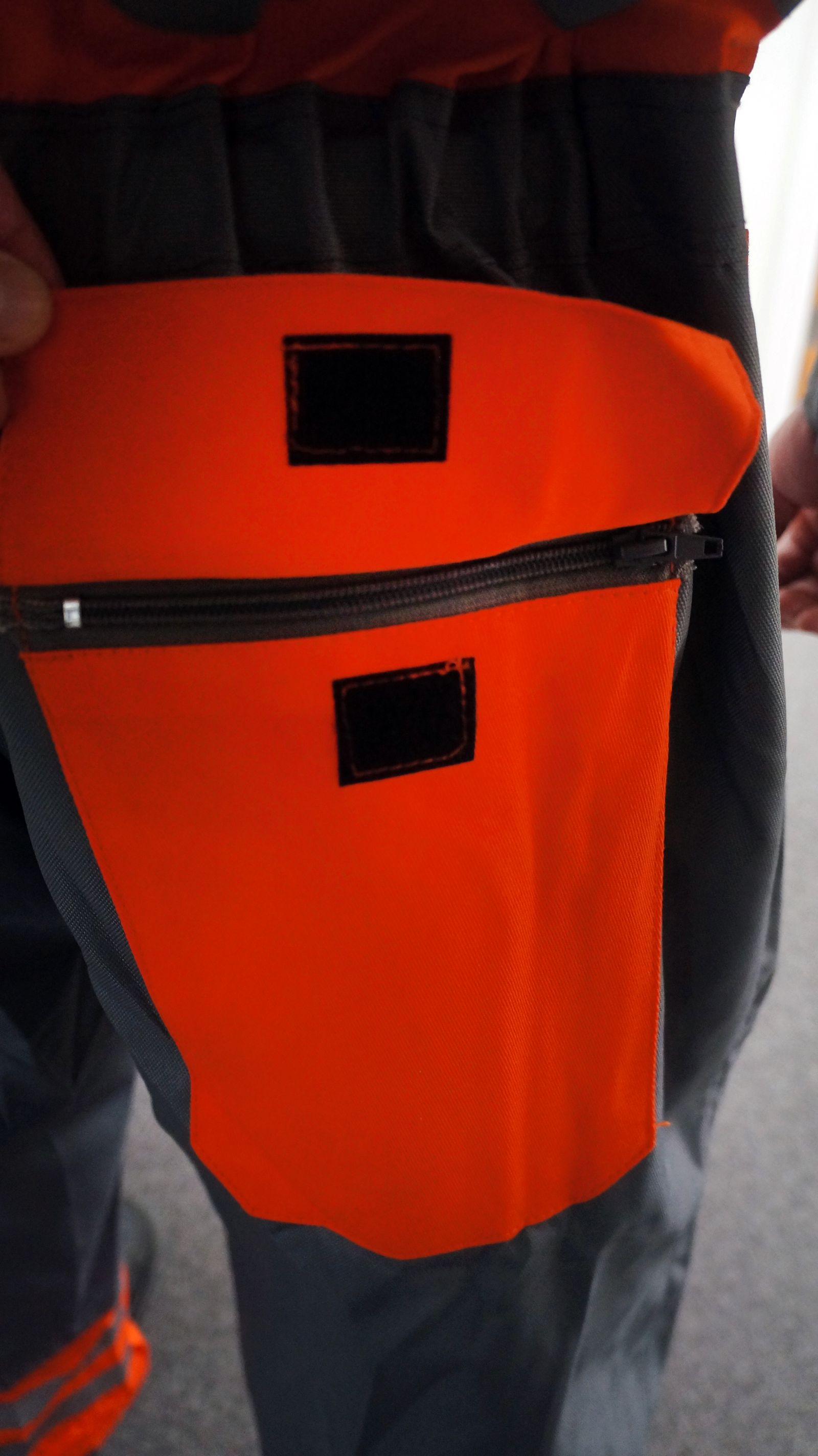 sj blast suit zip and velcro pocket